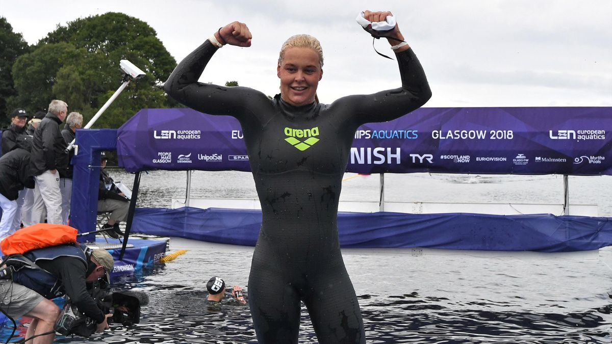 Sharon Van Rouwendaal celebrates after taking gold me in the women's 5km open water swimming at Loch Lomond, northwest of Glasgow, on August 8, 2018 during the 2018 European Championships.