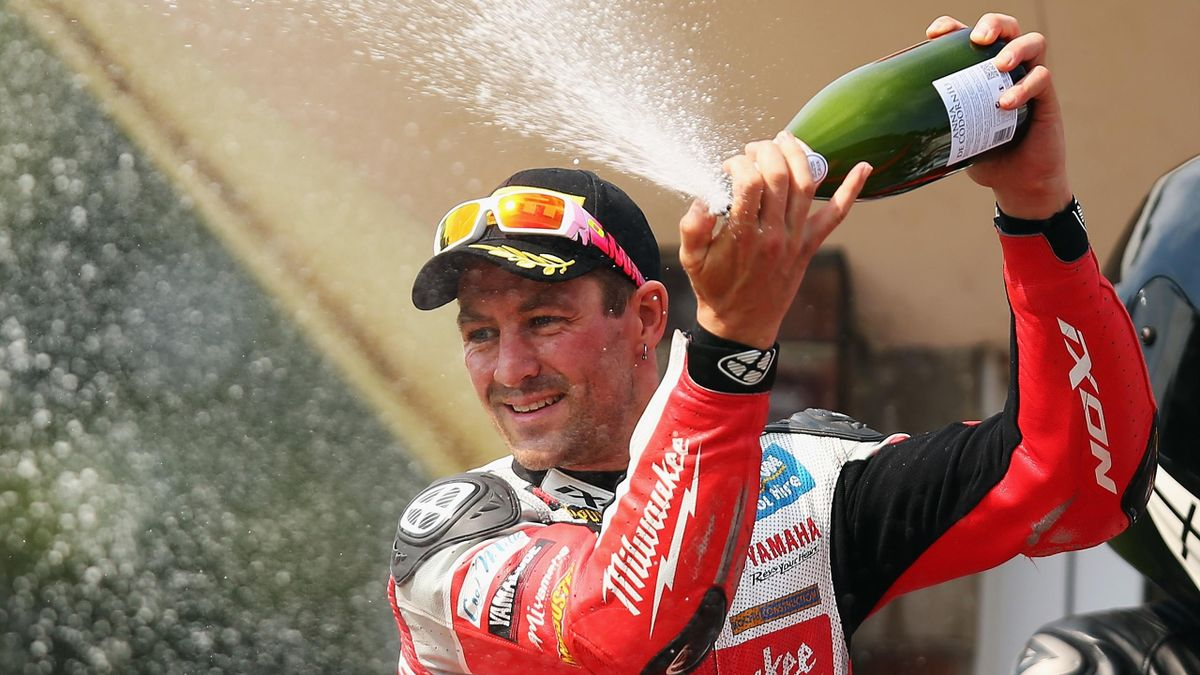 Josh Brookes of Australia and Milwaukee Yamaha stands on the podium after winning race one of the MCE British Superbike Championship at Cadwell Park on August 23, 2015 in Louth, England.
