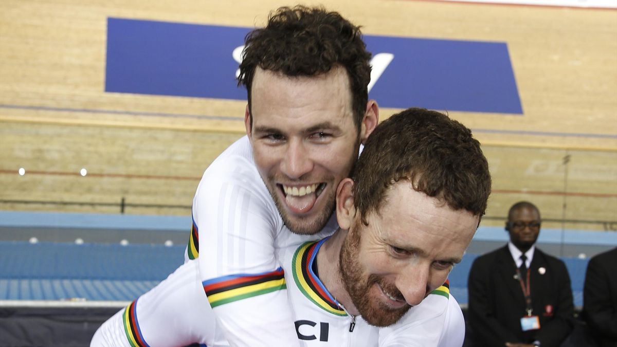 Gold medallists Britain's Bradley Wiggins gives a piggy back to Britain's Mark Cavendish after the Men's Madison final during the 2016 Track Cycling World Championships at the Lee Valley VeloPark in London on March 6, 2016
