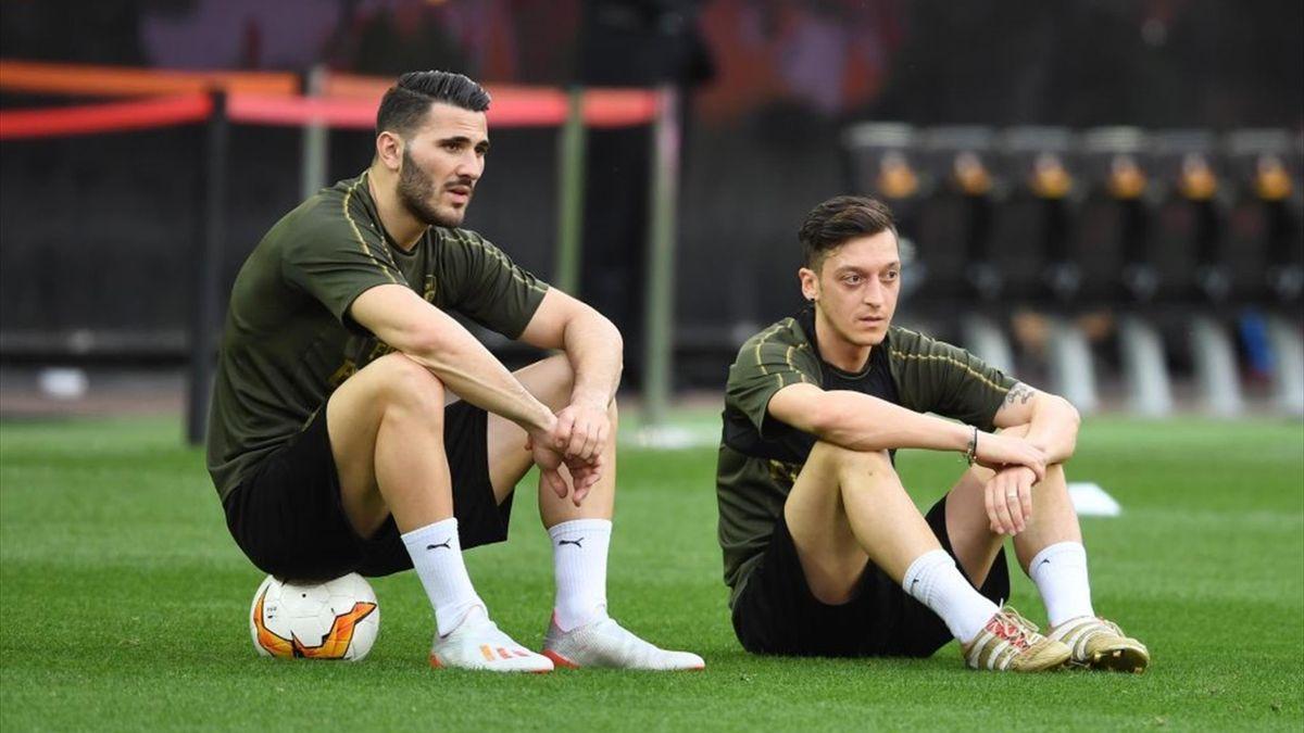 Sead Kolasinac and Mesut Ozil of Arsenal during a training session at Estadio Mestalla