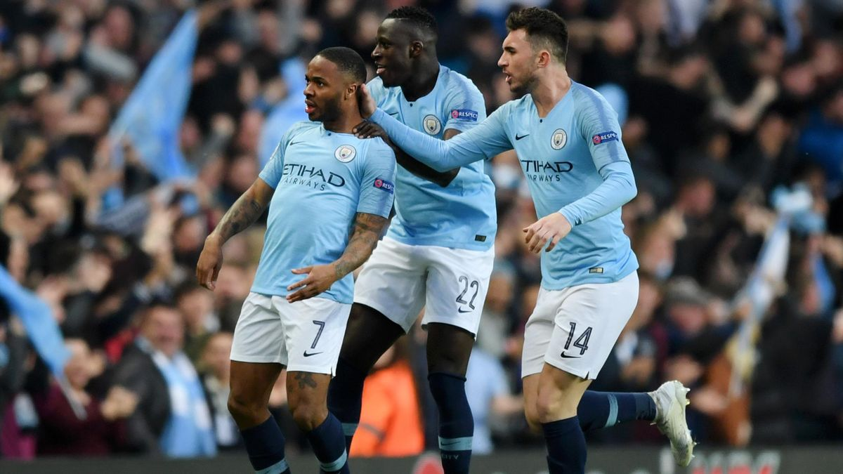 Raheem Sterling of Manchester City celebrates with teammates Benjamin Mendy and Aymeric Laporte after scoring his team's first goal during the UEFA Champions League Quarter Final second leg match between Manchester City and Tottenham Hotspur at at Etihad