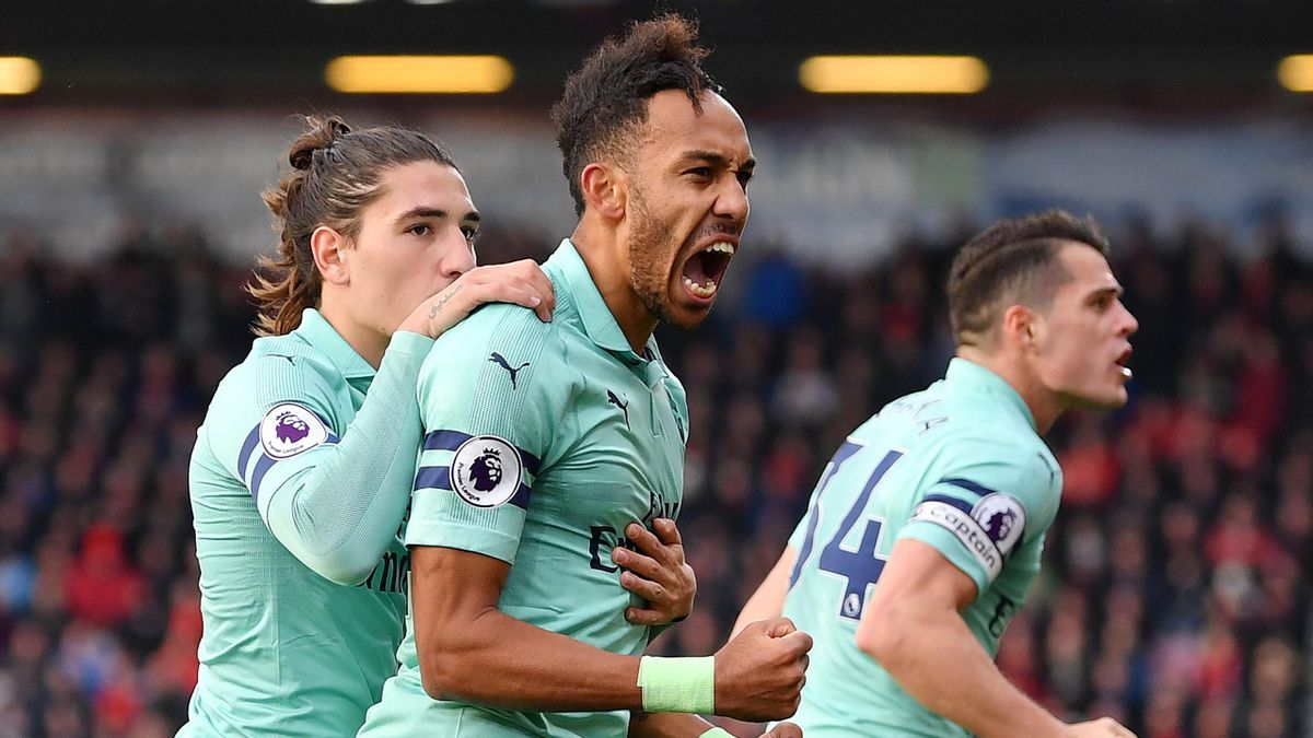 Pierre-Emerick Aubameyang of Arsenal celebrates after scoring his team's second goal with Hector Bellerin during the Premier League match between AFC Bournemouth and Arsenal FC at Vitality Stadium on November 25, 2018 in Bournemouth, United Kingdom.