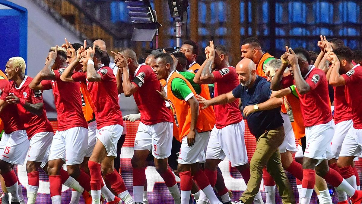 Madagascar's players celebrates after scoring their second goal during the 2019 Africa Cup of Nations (CAN) Group B football match between Madagascar and Nigeria at the Alexandria Stadium on June 30, 2019