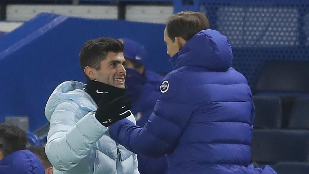 Chelsea's German head coach Thomas Tuchel (R) speaks to Chelsea's US midfielder Christian Pulisic during the English Premier League football match between Chelsea and Wolverhampton Wanderers at Stamford Bridge in London on January 27, 2021