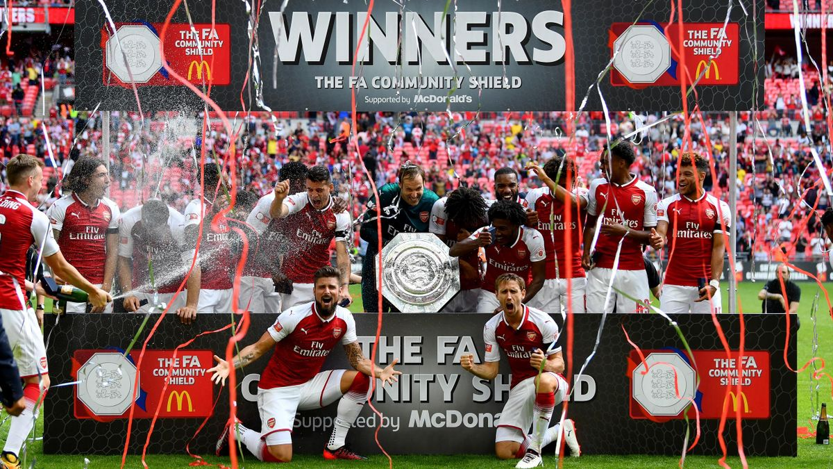 Arsenal team celebrate with the trophy following the The FA Community Shield