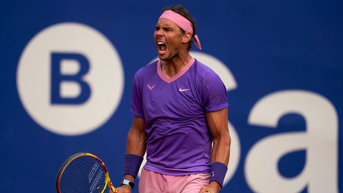 Rafael Nadal of Spain celebrates after winning match point during his Men's Singles round of 16 match against Kei Nishikori