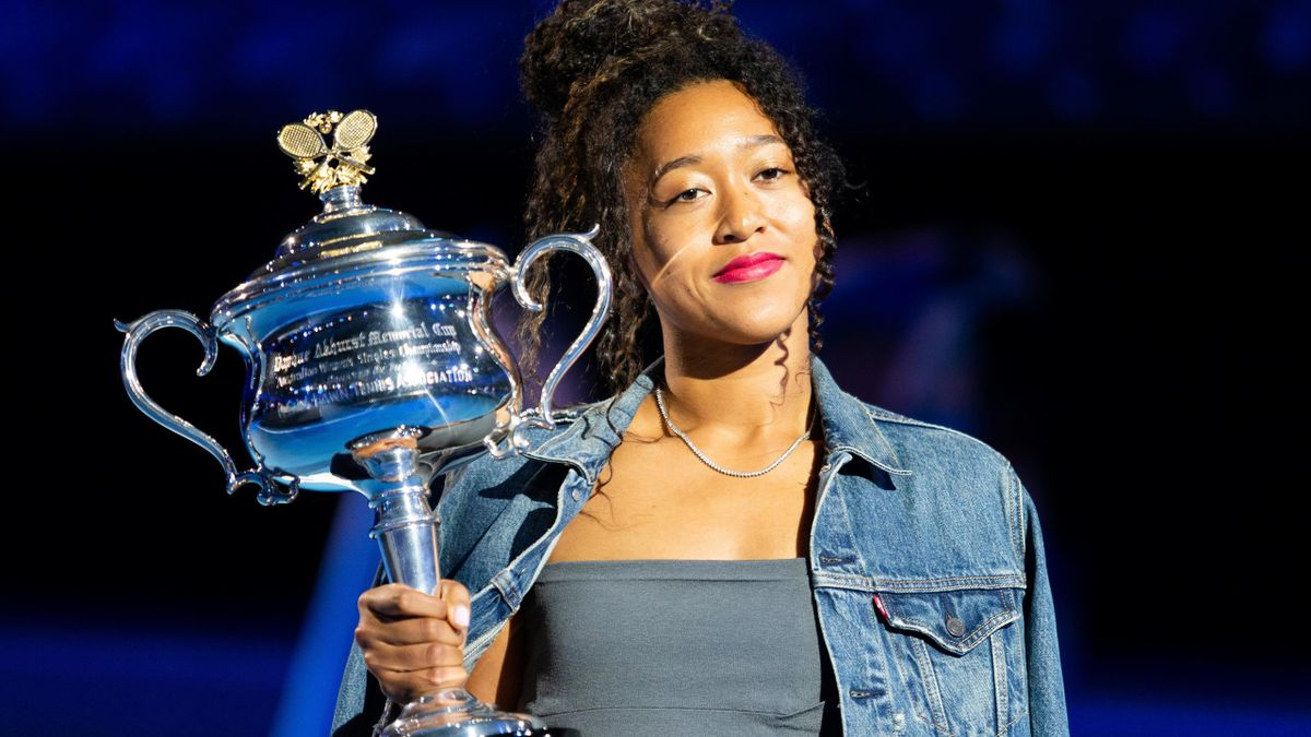 Naomi Osaka of Japan poses with the women's singles championship trophy during the draw announcement of the Australian Open tennis tournament in Melbourne