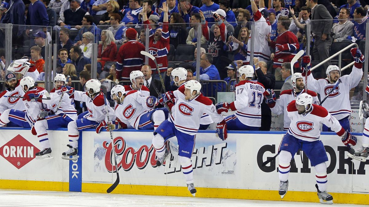 Montreal Canadiens players leap off the bench in celebration after the game-winning goal is scored by center Alex Galchenyuk during overtime in game three of the Eastern Conference Final (Reuters)