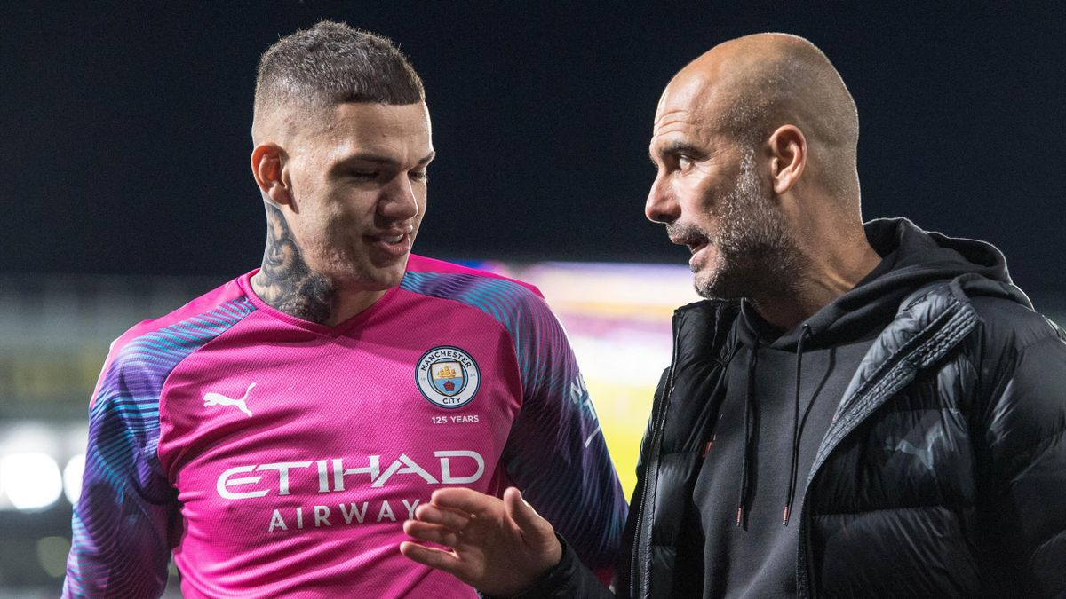 Ederson and manager Pep Guardiola of Manchester City