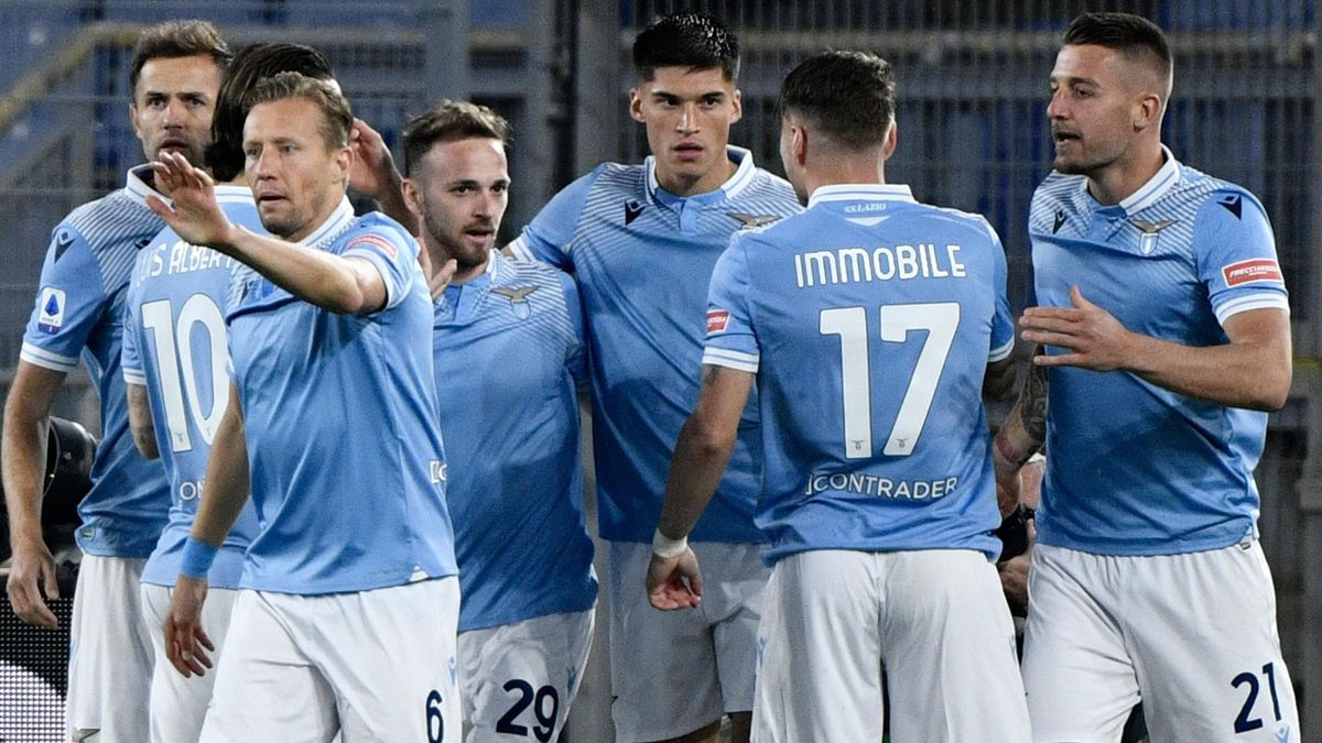 Lazio's Argentine forward Joaquin Correa (C) is congratulated by teammates during the Italian Serie A football match Lazio vs Ac Milan at Olympic stadium in Rome on April 26, 2021.