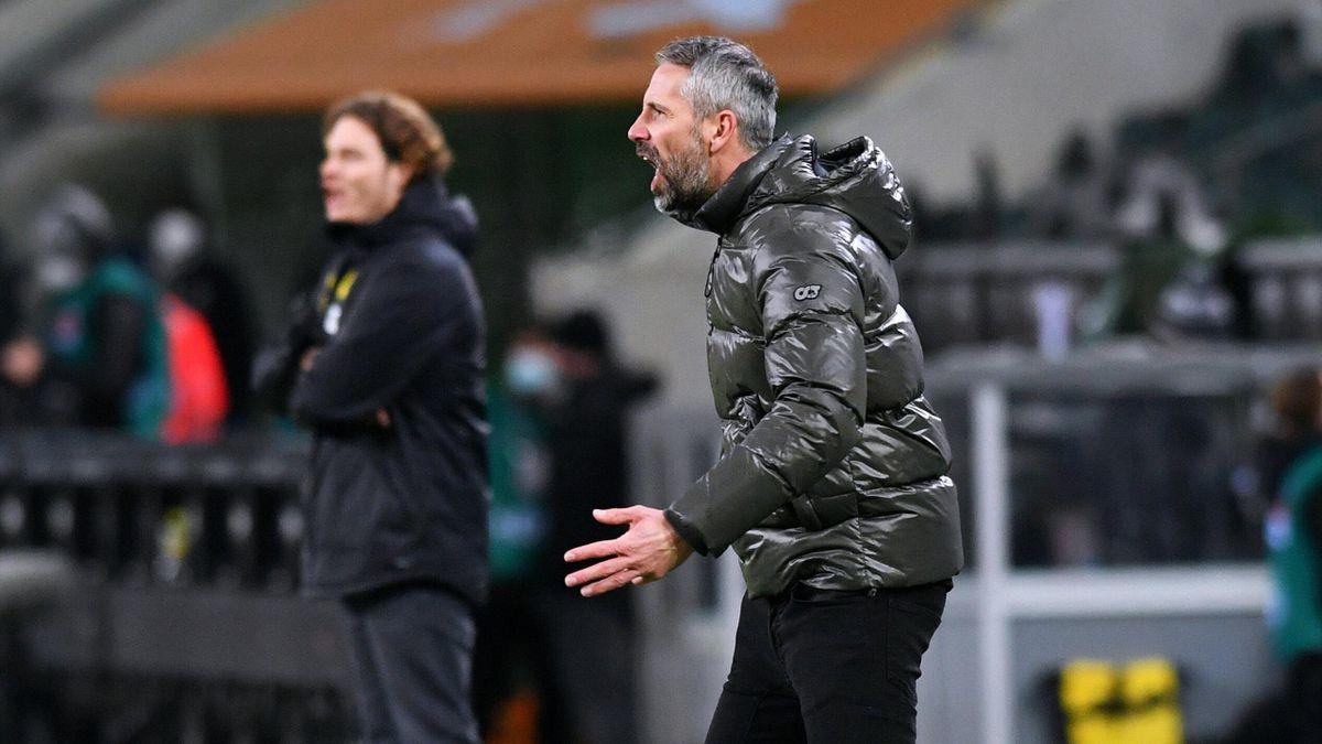 Marco Rose (vorne, Borussia Mönchengladbach) und Edin Terzic (Borussia Dortmund)