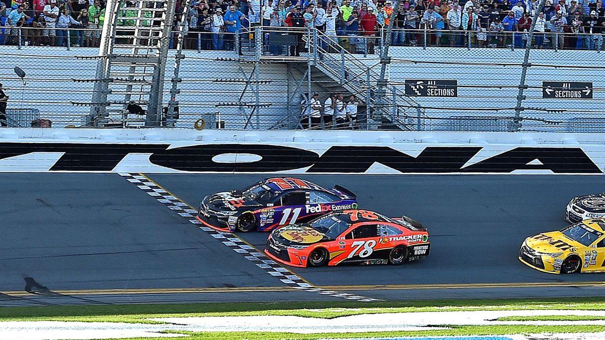 Denny Hamlin (11) beats NASCAR driver Martin Truex Jr. (78) to win the Daytona 500