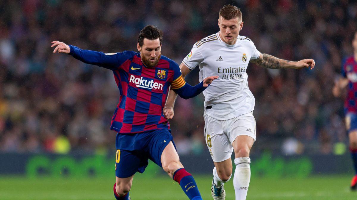 Lionel Messi (l.) im Zweikampf mit Toni Kroos