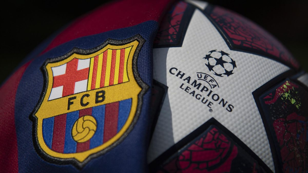 The FC Barcelona club crest on the first team home shirt with the UEFA Champions League match ball on August 14, 2020 in Manchester, United Kingdom