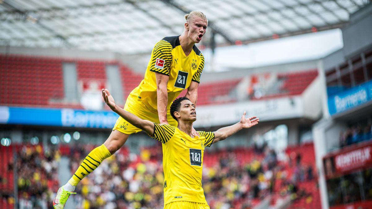 Jude Bellingham (R) and Erling Haaland (L) of Dortmund celebrate a goal that is later disallowed during the Bundesliga match between Bayer 04 Leverkusen and Borussia Dortmund at BayArena on September 11, 2021 in Leverkusen, Germany.