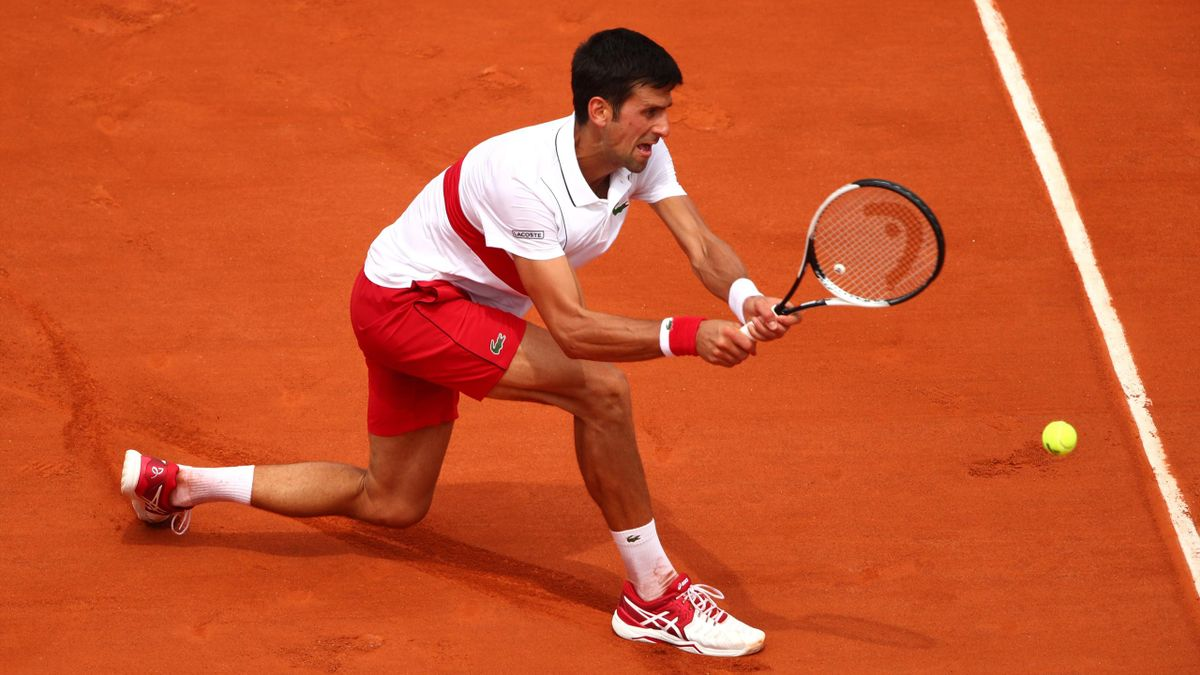 Novak Djokovic of Serbia plays a backhand