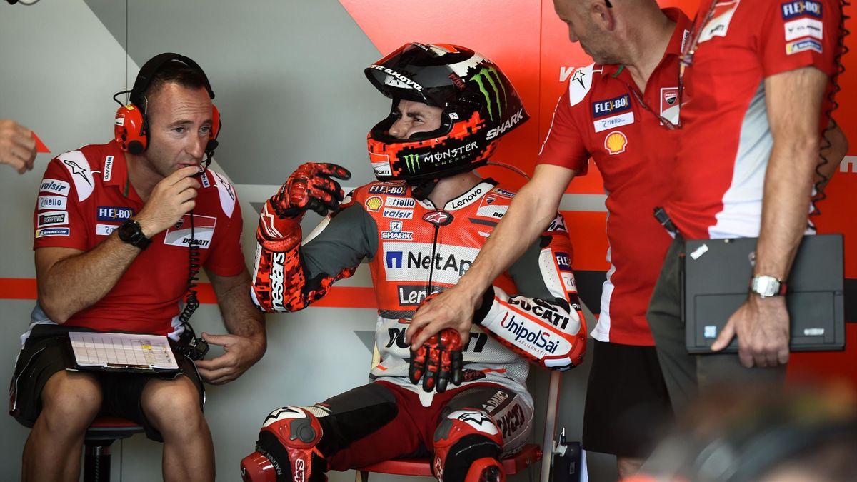 Ducati Team's Spanish rider Jorge Lorenzo speaks to his team during the free practice session of Thailand's inaugural MotoGP at Buriram International Circuit in Buriram on October 5, 2018