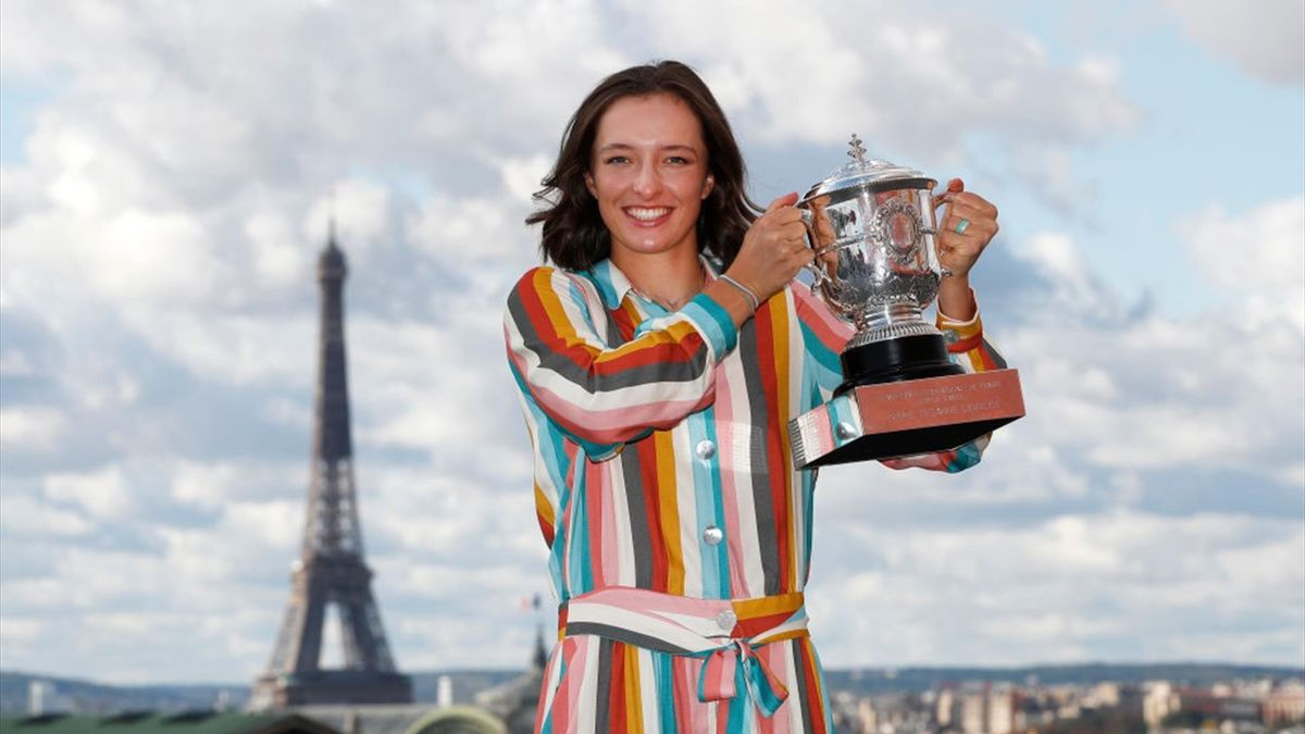 Iga Swiatek of Poland poses on the rooftop of les Galeries Lafayettes Rue de la Chaussee d'Antin with the Suzanne Lenglen Cup following her victory in the Women's Singles Final against Sofia Kenin of The United States of America on day fifteen of the 2020