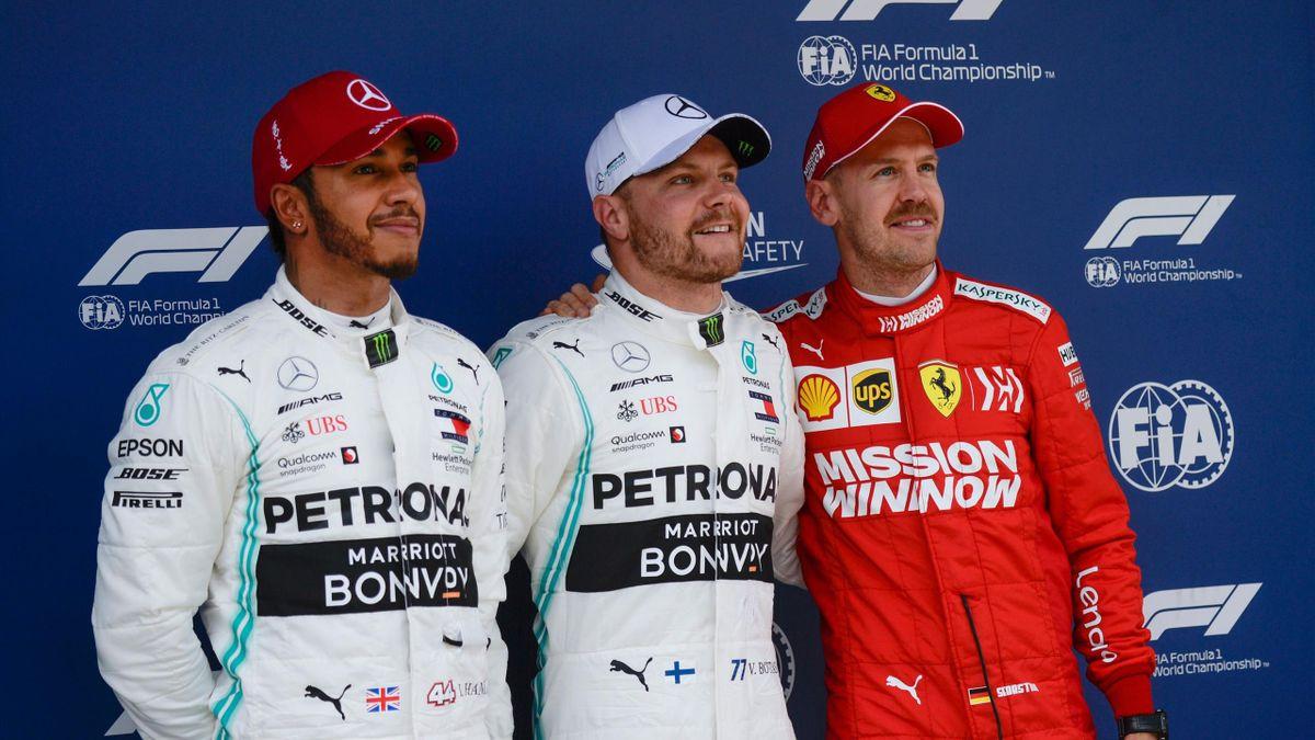 Mercedes' Finnish driver Valtteri Bottas (C) poses with second fastest Mercedes' British driver Lewis Hamilton (L) and third fastest Ferrari's German driver Sebastian Vettel (R)