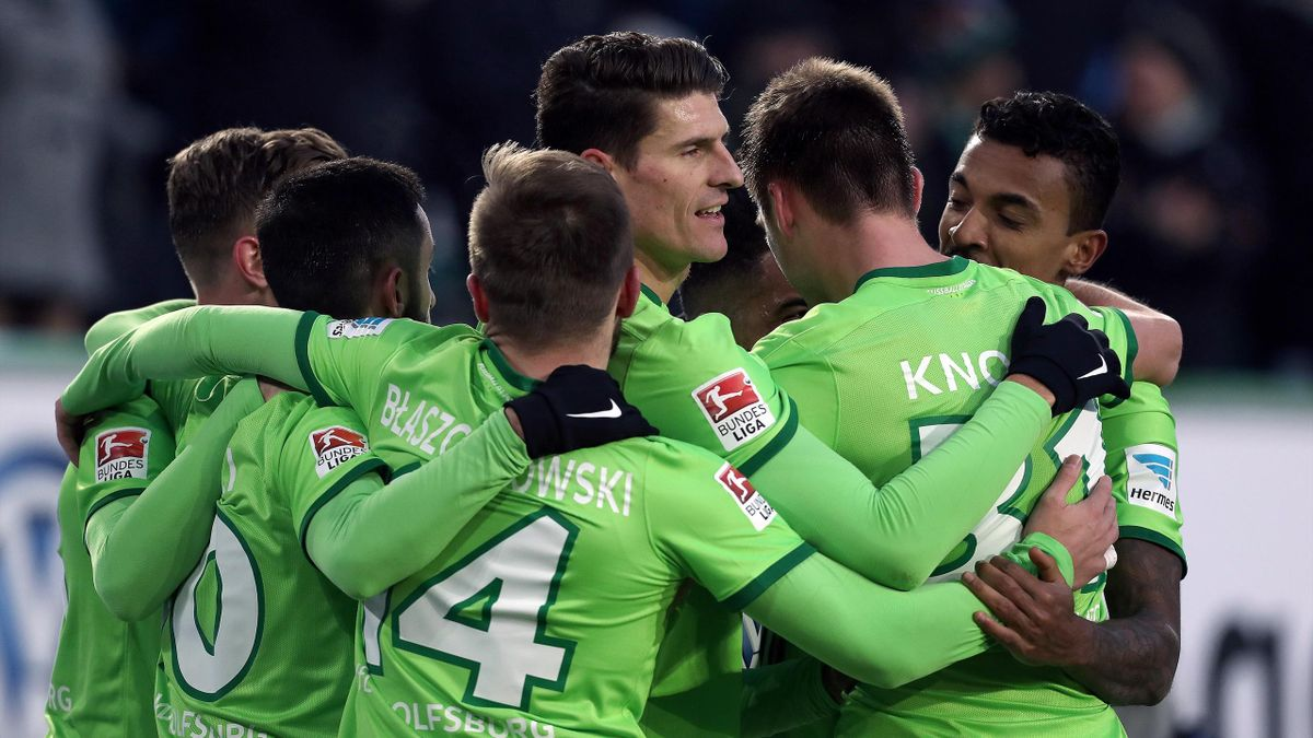 Wolfsburg's forward Mario Gomez (C) of Wolfsburg and team mates celebrate their team'S second goal during the German First division Bundesliga football match between VfL Wolfsburg v TSG Hoffenheim 1899 in Wolfsburg, on February 12, 2017.
