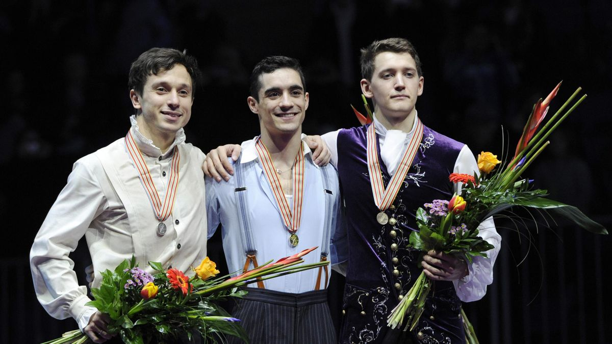 Gold medalist Javier Fernandez of Spain (C), silver medalist Alexei Bychenko of Israel and the bronze medalist Maxim Kovtun (R) of Russia pose at the podium during men's free skating event during the European Figure Skating Championship in Bratislava