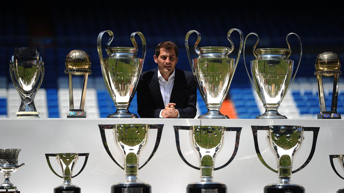 3: Iker Casillas poses behind trophies he has won during his career in Real Madrid after holding a press conference with Real president Florentino Perez at the Santiago Bernabeu stadium to announce that he will be leaving Real Madrid football team on July