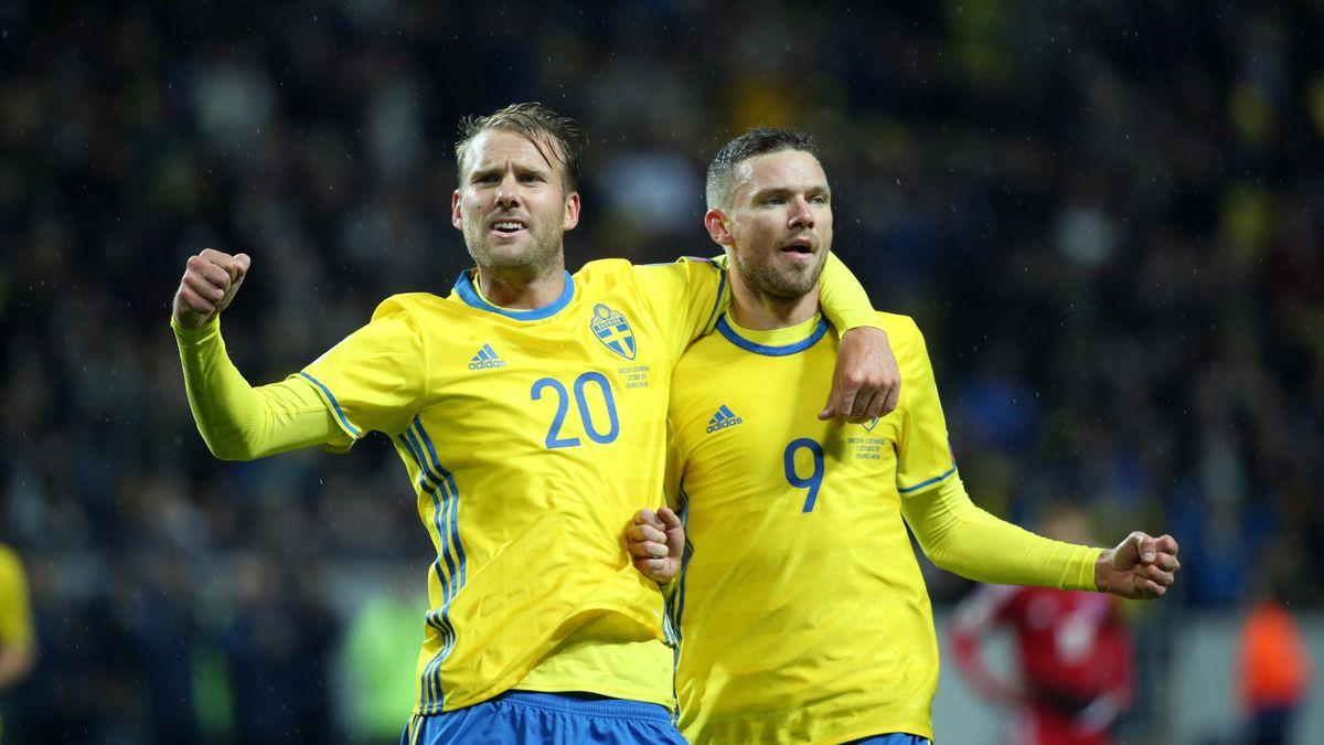 Sweden's Marcus Berg celebrates with teammate Ola Toivonen