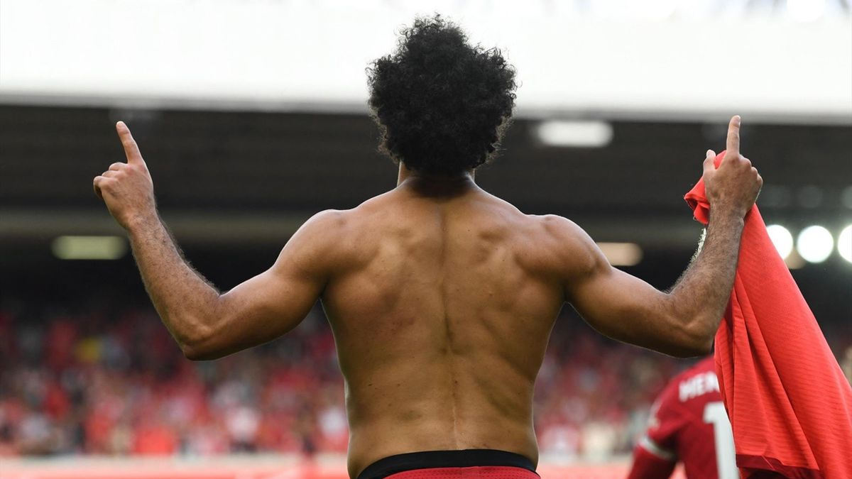 Liverpool's Egyptian midfielder Mohamed Salah celebrates after scoring their second goal during the English Premier League football match between Liverpool and Crystal Palace at Anfield in Liverpool, north west England on September 18, 2021.