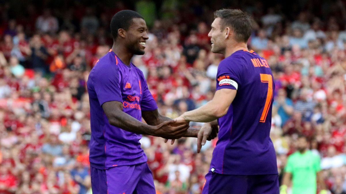 Georginio Wijnaldum (L) celebrates with James Milner (R)