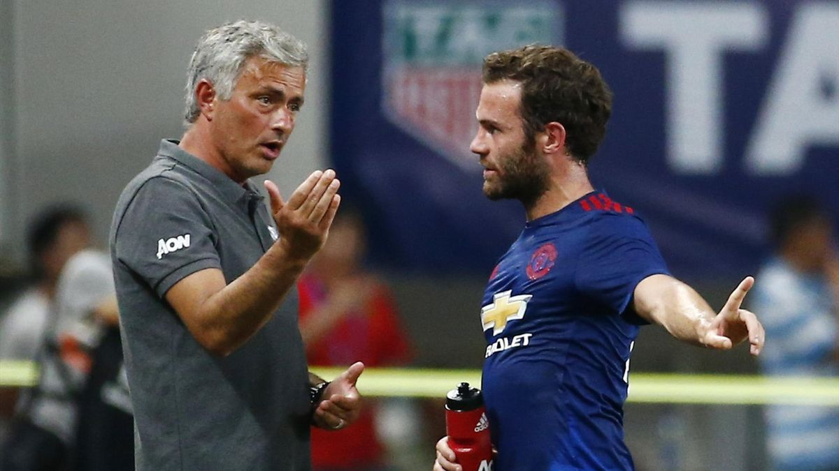 Juan Mata talks to Jose Mourinho