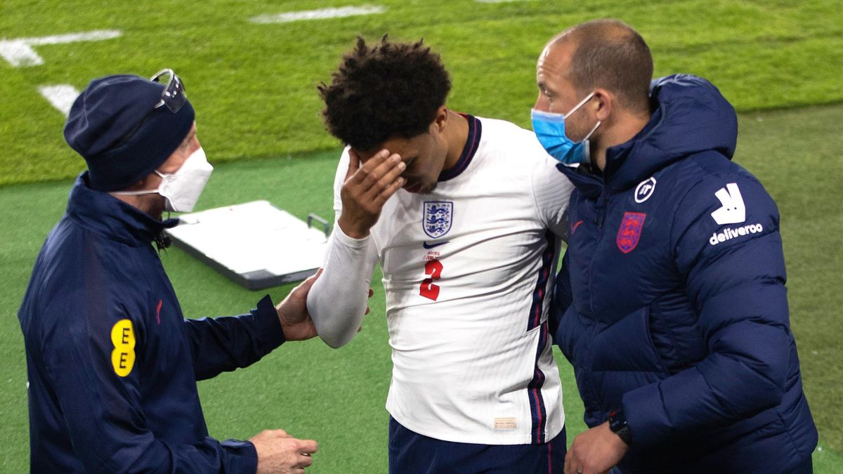 Trent Alexander-Arnold of England reacts after being substituted with a injury during the international friendly match between England and Austria