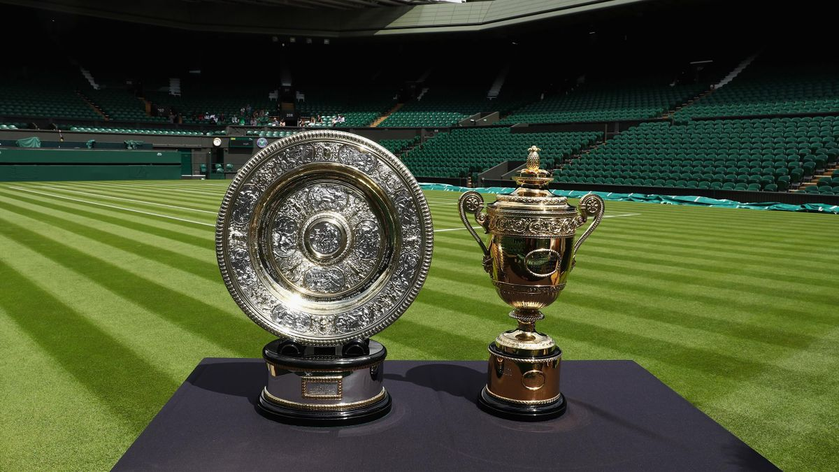 The Gentlemen's and Ladies' trophies are displayed on Centre Court during previews for Wimbledon Tennis 2016 at Wimbledon on June 25, 2016 in London, England