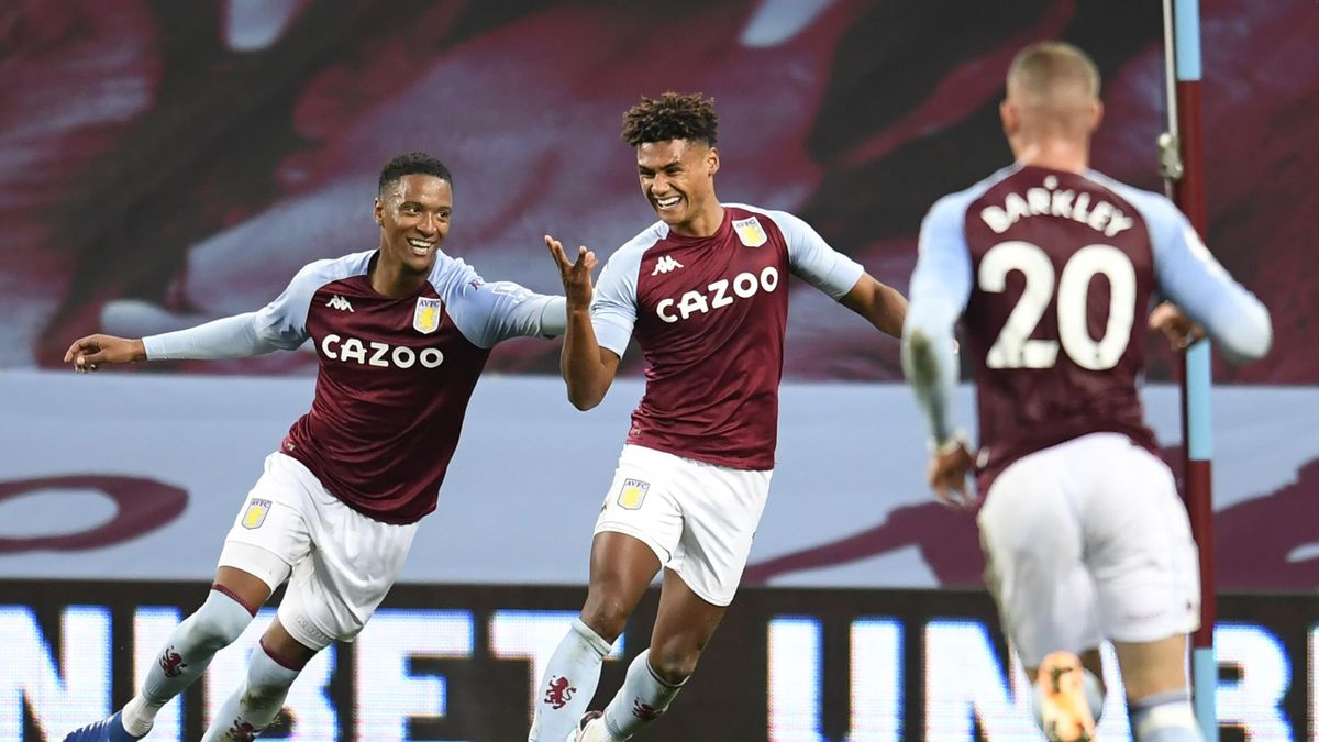Aston Villa's English striker Ollie Watkins (C) celebrates with teammates after scoring his third goal, their fourth during the English Premier League football match between Aston Villa and Liverpool at Villa Park