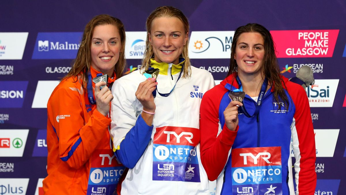 Bronze Medalist Charlotte Bonnet of France, Silver Medalist Femke Heemskerk of the Netherlands, and Gold medalist Sarah Sjoestroem of Sweden pose with their medals after the Women's 100m Freestyle Final during the swimming on Day seven of the European Cha