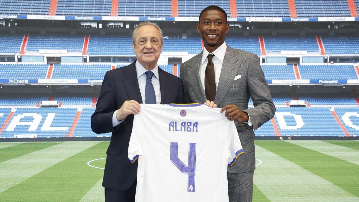 David Alaba poses with Florentino Perez after signing for Real Madrid, July 21, 2021