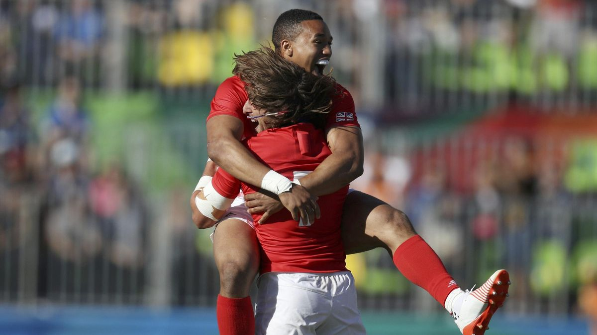 2016 Rio Olympics - Rugby - Men's Semifinals - Britain v South Africa - Deodoro Stadium - Rio de Janeiro, Brazil - 11/08/2016. Marcus Watson (GBR) of United Kingdom and Daniel Bibby (GBR) of United Kingdom celebrate their victory over South Africa.