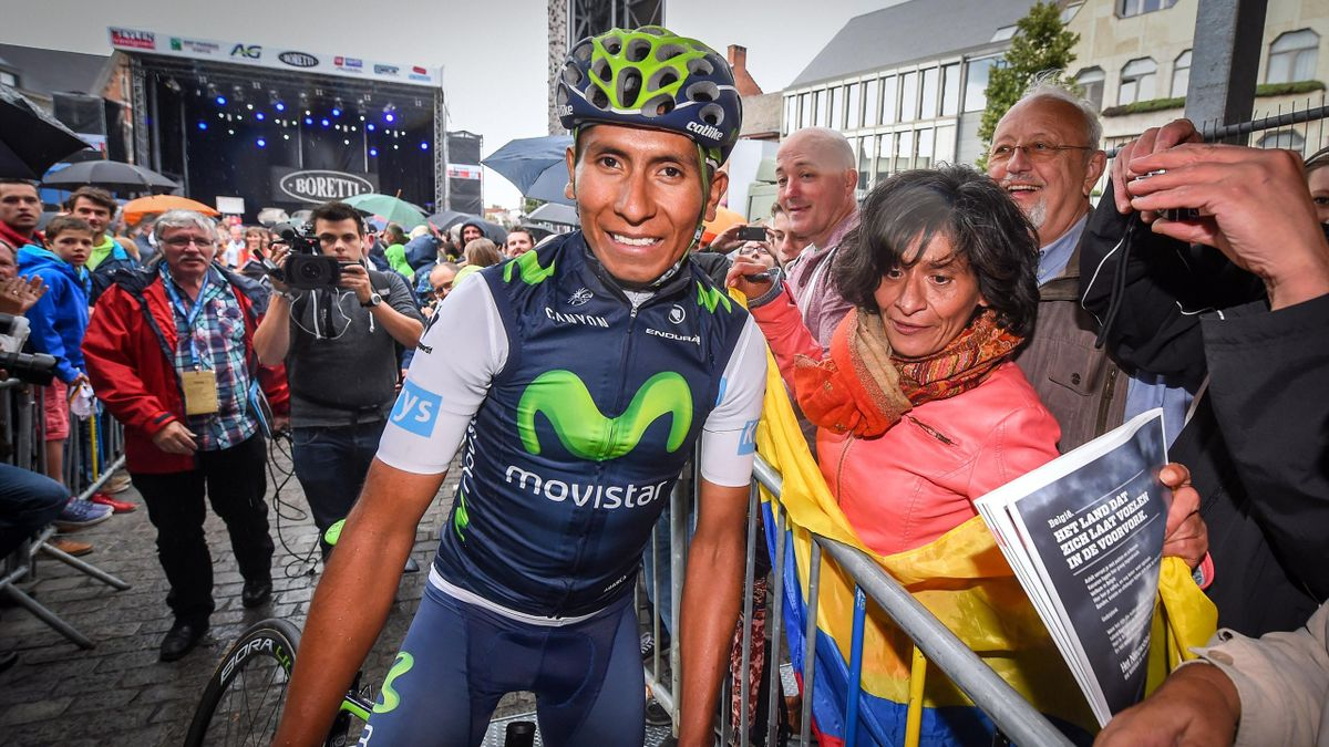 Colombian cyclist Nairo Quintana of Movistar Team smiles next to fans ahead of the 11th edition of the 'Natourcriterium van Herentals' cycling race in Herentals on July 30, 2015