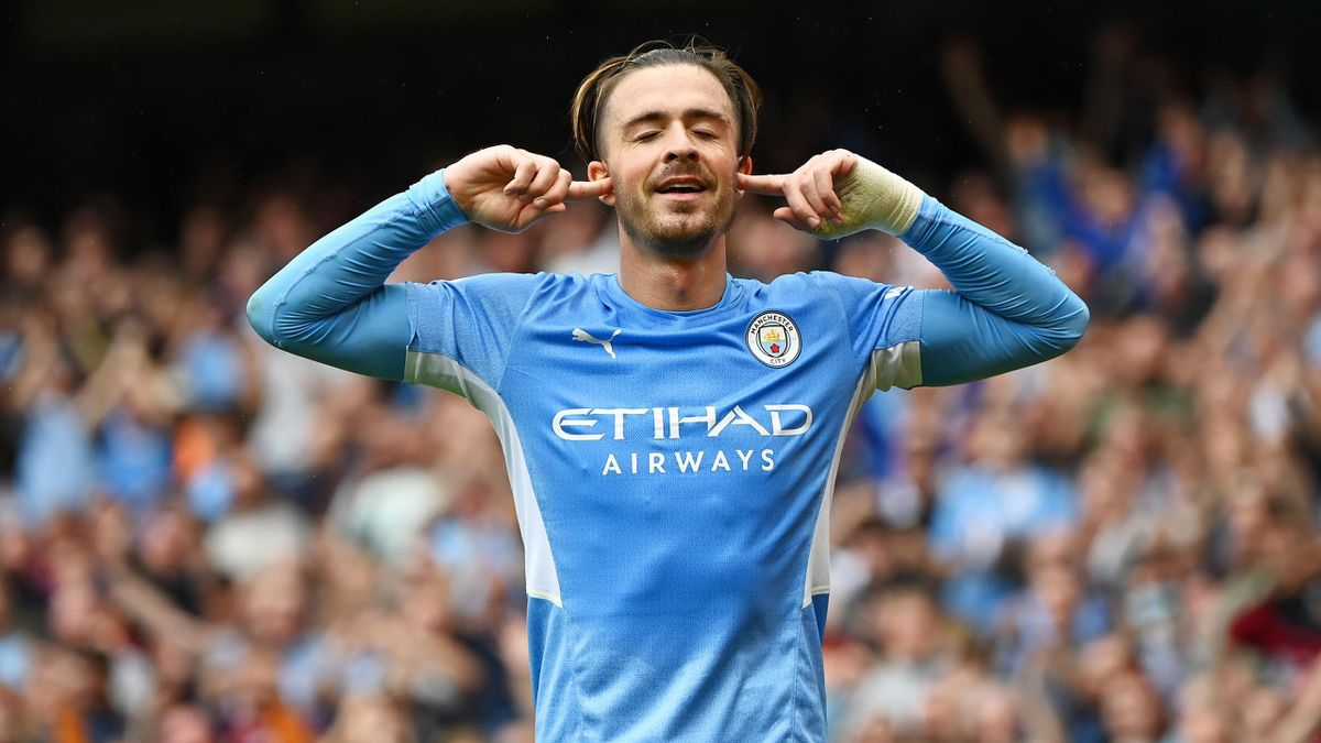 Jack Grealish of Manchester City celebrates after scoring their side's second goal during the Premier League match between Manchester City and Norwich City at Etihad Stadium on August 21, 2021 in Manchester, England.