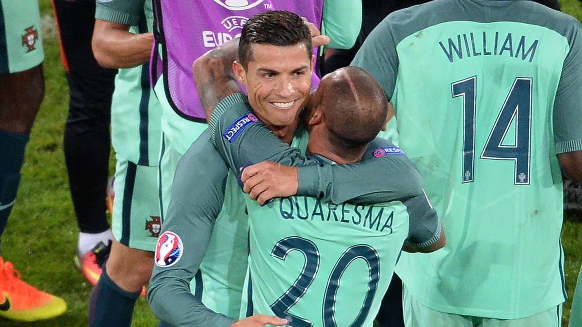 Portugal's forward Cristiano Ronaldo (L) celebrates with Portugal's forward Ricardo Quaresma at the end of the Euro 2016 round of sixteen football match Croatia vs Portugal, on June 25, 2016 at the Bollaert-Delelis stadium in Lens