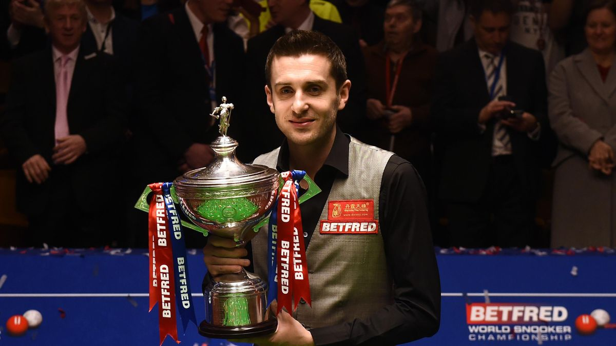 England's Mark Selby holds the trophy after beating China's Ding Junhui in the final of the World Snooker Championship at the Crucible theatre in Sheffield, northern England, on May 2, 2016