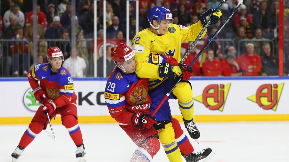 Joel Eriksson of Sweden challenges Ivan Provorov of Russia during the 2017 IIHF Ice Hockey World Championship game between Sweden and Russia at Lanxess Arena on May 5, 2017 in Cologne, Germany.