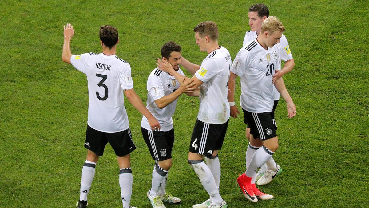 Germany's Amin Younes celebrates scoring their fourth goal with Matthias Ginter