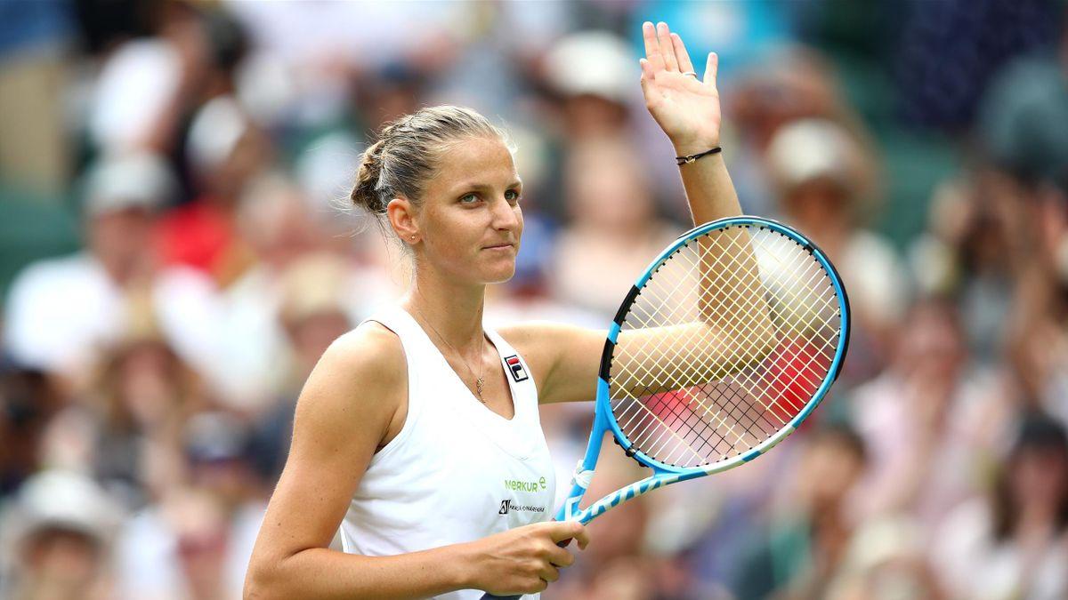 Karolina Pliskova of Czech Republic celebrates her victory over Victoria Azarenka of Belarus after their Ladies' Singles second round match on day three of the Wimbledon Lawn Tennis Championships