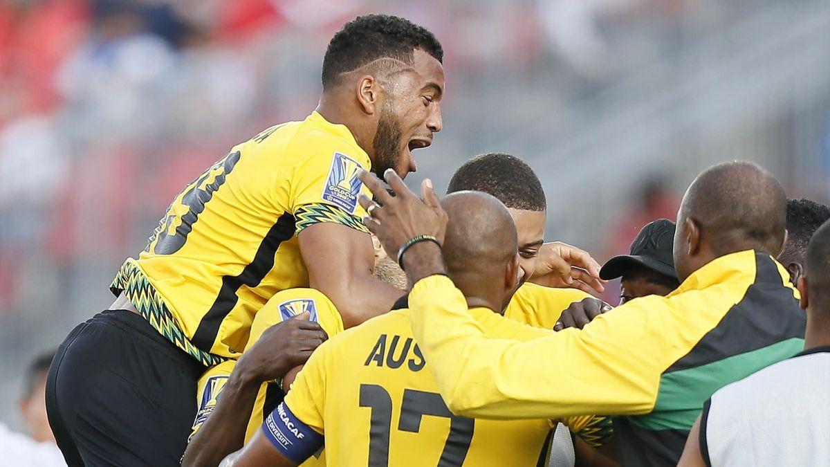 Jamaica defender Adrian Mariappa (19) and Jamaica midfielder Rudolph Austin (17) celebrate a goal against El Salvador