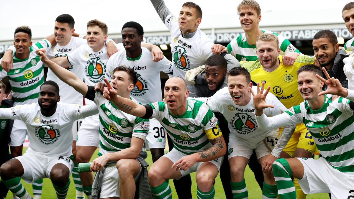 The Celtic team celebrate winning the match and the title after the Ladbrokes Scottish Premiership match between Aberdeen and Celtic at Pittodrie Stadium on May 04, 2019 in Aberdeen, Scotland.