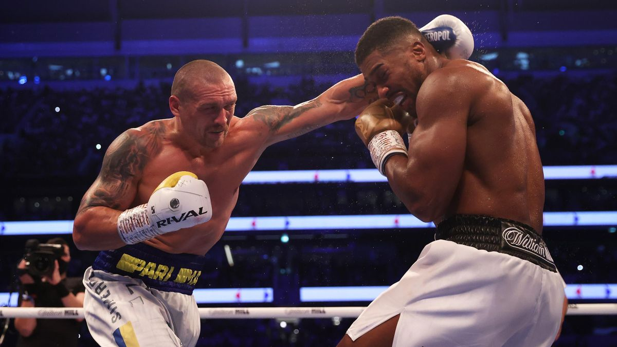 Oleksandr Usyk punches as Anthony Joshua ducks during the Heavyweight Title Fight between Anthony Joshua