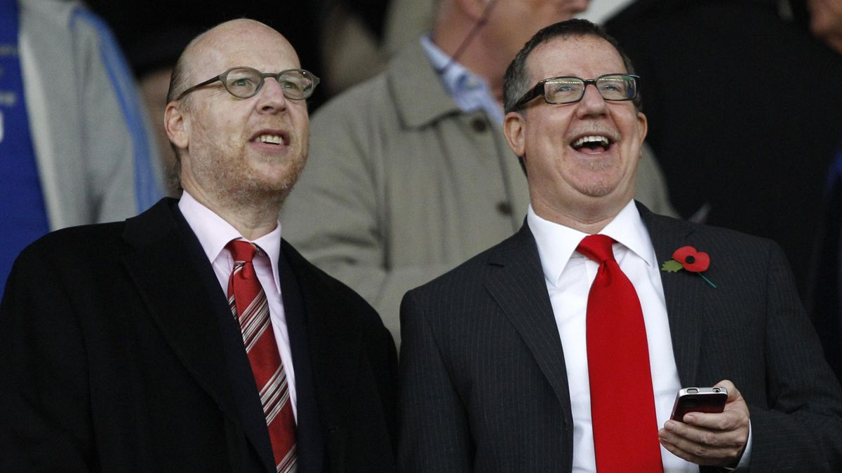 Manchester United board members Avram (L) and Brian Glazer attend the English Premier League football match against Manchester City at Old Trafford in Manchester, northern England, October 23, 2011 (Reuters)