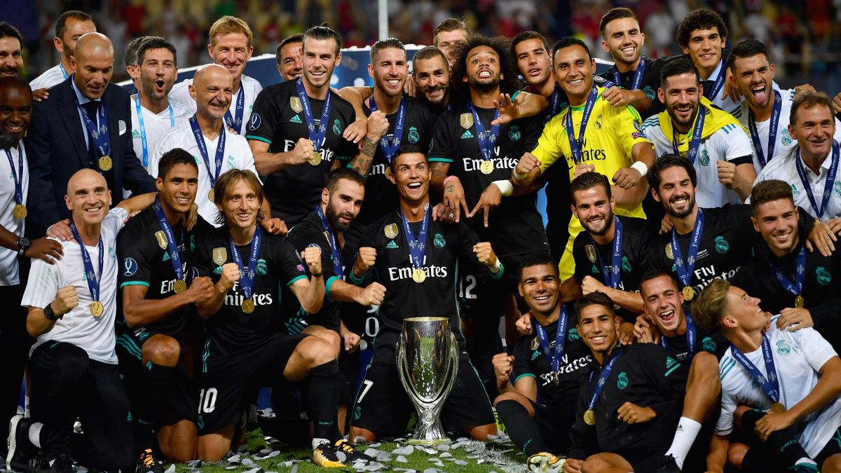 The Real Madrid team celebrate with UEFA Super Cup trophy after the UEFA Super Cup final between Real Madrid and Manchester United at the Philip II Arena on August 8, 2017.