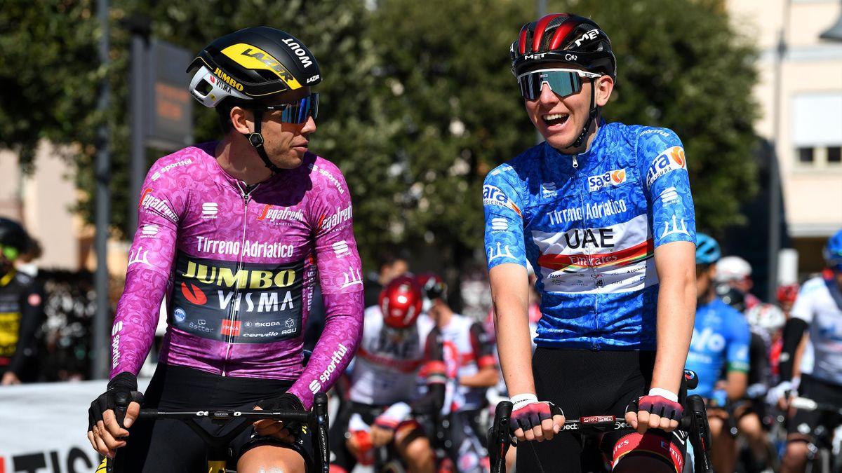 Wout van Aert and Tadej Pogacar share a joke on the start line at Tirreno Adriatico