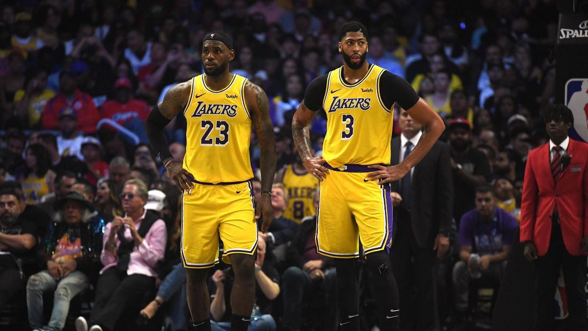 LeBron James #23 and Anthony Davis #3 of the Los Angeles Lakers reacts as they trail the LA Clippers during the fourth quarter in a 112-102 Clippers win during the LA Clippers season home opener at Staples Center on October 22, 2019 in Los Angeles, Califo